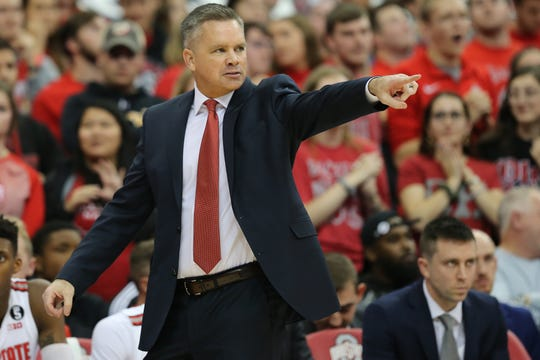 Ohio State Buckeyes head coach Chris Holtmann instructs the team in the first half of a college basketball game against the Cincinnati Bearcats on Nov. 6 at Value City Arena.