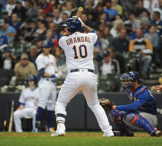 Sep 8, 2019; Milwaukee, WI, USA; Milwaukee Brewers catcher Yasmani Grandal (10) at bat at Miller Park. Mandatory Credit: Michael McLoone-USA TODAY Sports
