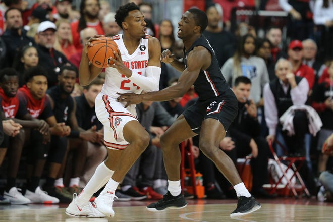 Cincinnati Bearcats guard Keith Williams (2) defends on Ohio State Buckeyes forward Andre Wesson (24) in the first half of a college basketball game, Wednesday, Nov. 6, 2019, at Value City Arena in Columbus, Ohio.