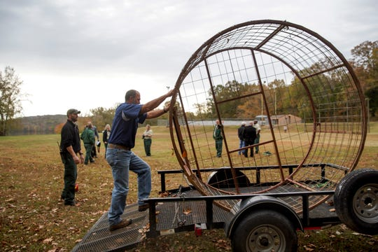 David Lingo pushes one of the cages used to trap feral pigs back up onto his trailer at Brandon Spring in Land Between the Lakes, Tenn., on Wednesday, Nov. 6, 2019.