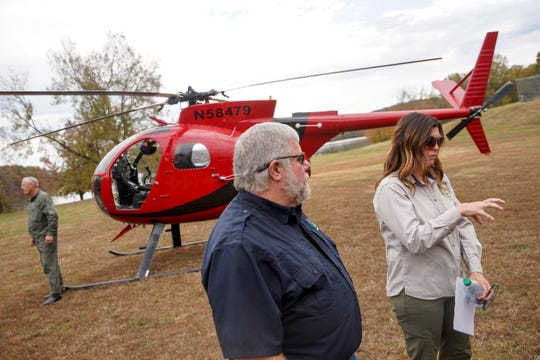 Brad Robbins of USDA Wildlife Services and Terri Brunjes, the wild pig biologist for Kentucky Fish & Wildlife, explain the usage of helicopters in rounding up feral pigs to control the population at Brandon Spring in Land Between the Lakes, Tenn., on Wednesday, Nov. 6, 2019.