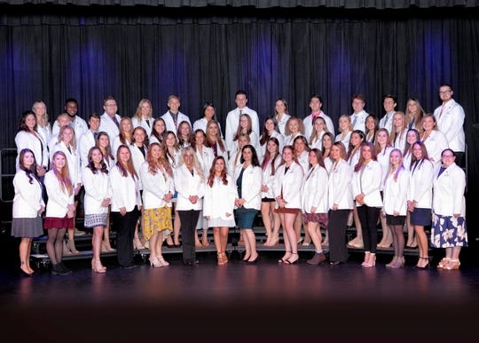 The Department of Nursing at Misericordia University held its Gold-AACN White Coat Ceremony for Nursing by cloaking nursing students who began the professional portion of the nursing program in the fall semester. Participating in the program, first row from left, are Ashlie Dubil,  Angela Lockavich, Lauren Dicarlo, Kerstyn Klinger,  Tabitha Mentz,  Cheryl Milefsky,  Madison Shappell, Roseanne Edwards,  Meagan Yoder, Sarah Perkalis, Jordyn Wynder, Amanda Paglianite, Kendra Percodani, Drew Bednarski, and Valerie Yeck, second row, Colby Gibbons,   Arthur Quade,  Hayley Engle, Kylan Kurtz, Katelyn Ponce, Elizabeth Lachenal, Brooke Stevens,Hallie Stark, Mallory Foster, Jaycie Fought, Summer Franklin, Kirsten Scholl, Olivia Conklin,  Hailley Brown, Kaylie Grosvenor, Megen Banas, Haley Carey, Samantha Basch,  Kait Miller, Candace Balavage, Sierra Ward, Marykate Guerriero, Danielle Chee,  Alaina Nastasiak, Courtney Henninger, Alexandria Dougherty, and Audrey Oakschunas, third row, Alexis Barsh, Smiles Nwachukwu, Bradley Duda, Dana Stroup, Isaiah Derr, Brea Seabrook, Lawrence Michalski, Shelby Hastings, Brendan Liddy, Nicholas Neidlinger, Christopher Sedeski, Jessia Celzo, and Marc Welch
