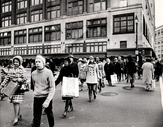 Shoppers cross Woodward under the watchful eye of traffic police who sound directions from their Hudson's lookout in 1970.