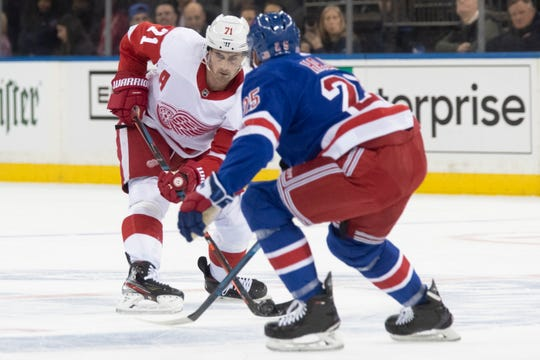 Detroit Red Wings center Dylan Larkin (71) skates against New York Rangers defenseman Libor Hajek (25) during the first period of an NHL hockey game, Wednesday, Nov. 6, 2019, at Madison Square Garden in New York.