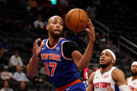 New York Knicks forward Taj Gibson grabs a rebound during the second half of an NBA basketball game against the Detroit Pistons, Wednesday, Nov. 6, 2019, in Detroit. (AP Photo/Carlos Osorio)