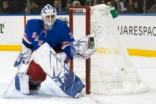 New York Rangers goaltender Henrik Lundqvist makes a save against the Detroit Red Wings during the first period of their NHL hockey game, Wednesday, Nov. 6, 2019, at Madison Square Garden in New York.