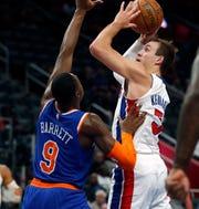 Detroit Pistons guard Luke Kennard (5) shoots over New York Knicks guard RJ Barrett (9) during the first half of an NBA basketball game, Wednesday, Nov. 6, 2019, in Detroit.