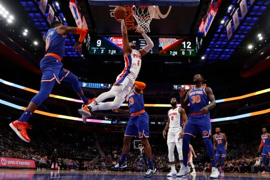 Detroit Pistons guard Bruce Brown (6), defended by New York Knicks guard Frank Ntilikina (11) makes a layup during the first half of an NBA basketball game, Wednesday, Nov. 6, 2019, in Detroit.
