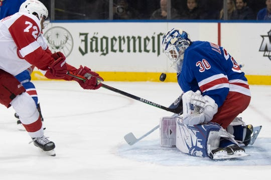 New York Rangers goaltender Henrik Lundqvist (30) makes the save against Detroit Red Wings center Andreas Athanasiou (72) during the first period of an NHL hockey game, Wednesday, Nov. 6, 2019, at Madison Square Garden in New York.