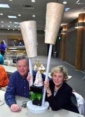 Tim Hefferon and his wife, Leeann Konrad, with their 1950s lamp. Leeann Konrad grew up with the rotating lamp in her family's home.
