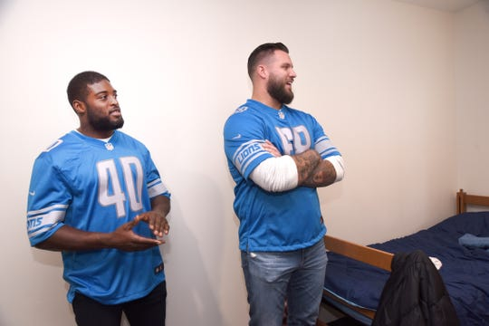 From left, Detroit Lions Jarrad Davis and Taylor Decker at Covenant House of Michigan.