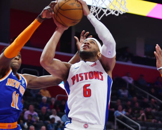 Pistons' Bruce Brown shoots over the Knicks' Frank Ntilikina in the first quarter.