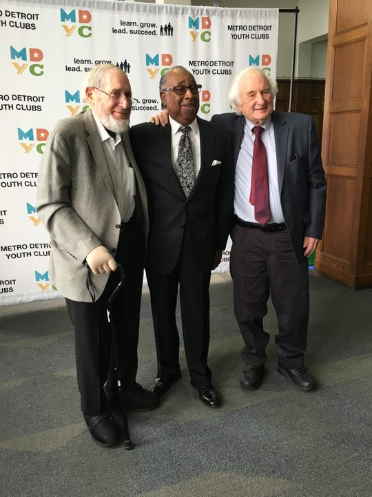 Former U.S. Sen. Carl Levin, D-Detroit (left), businessman Jim Comer and ex-U.S. Rep. Sander Levin, D-Royal Oak, celebrate the dedication of a new youth club at the Durfee Innovation Society in Detroit named the Levin-Comer Club. Nov. 7, 2019