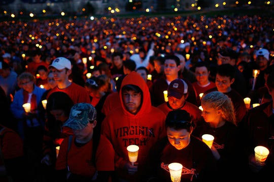 Thousands of Virginia Tech students take part in a mass candlelight vigil to honor the victims of the campus shootings April 17, 2007 in Blacksburg, Virginia. Thirty-two people were killed when a gunman opened fire on the campus, before turning the gun on himself.