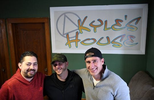 From left, Carl Brune, 31, is photographed at Kyle's House, a 3/4 house, with current house manager Ryan Geml, 32, and Andrew Fortunato, 33, Brune's sponsor and manager of the house at the time Brune was there,  in Warren on Nov. 3.