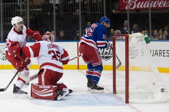 New York Rangers center Ryan Strome (16) scores a goal past Detroit Red Wings goaltender Jimmy Howard (35) during the second period.