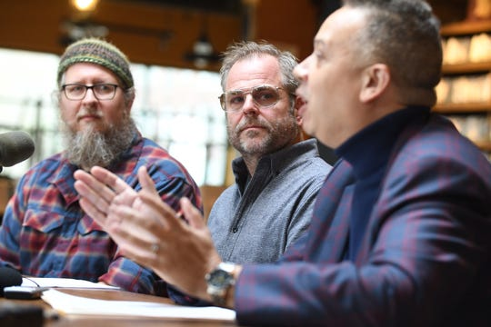 Dave Engbers (from left) and Mike Stevens, co-founders of Founders Brewing, listen to Buzz Thomas, interim director, diversity equity and inclusion for Founders, about the future of the Detroit taproom.