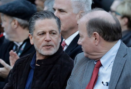 Quicken Loans founder Dan Gilbert, left, meets with Detroit Mayor Mike Duggan at the former site of the J.L. Hudson Co. department store, Thursday, Dec. 14, 2017, in Detroit. Ground was broken for a new 800-foot-tall, $900 million two-building project that will include a 58-story residential tower and 12-floor building for retail and conference space.