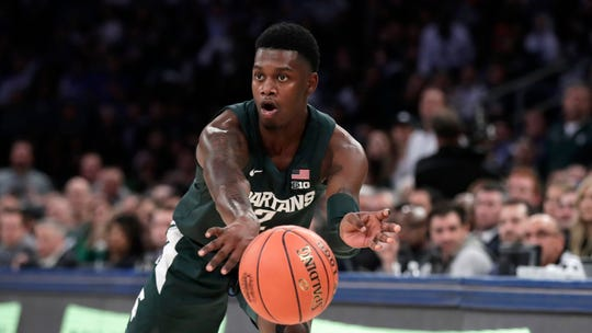Michigan State guard Rocket Watts passes during the first half.