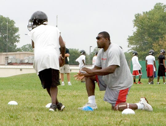 Tyrone Wheatley got his coaching start at Dearborn Heights Robichaud.