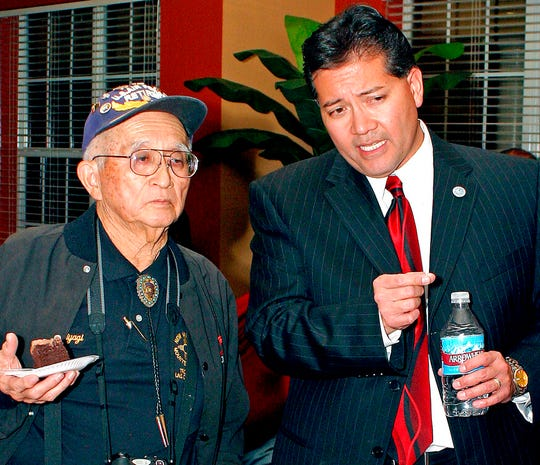 In this Nov. 6, 2007 file photo, Las Cruces Mayoral candidate Ken Miyagishima discusses the unofficial poll results with his father, Mike Miyagishima, during his election party at Casa de Soledad in Las Cruces, N.M. Ken Miyagishima, the son an internee at a World War II-era Japanese American internment camp, won his fourth term mayor on Tuesday, Nov. 5, 2019.