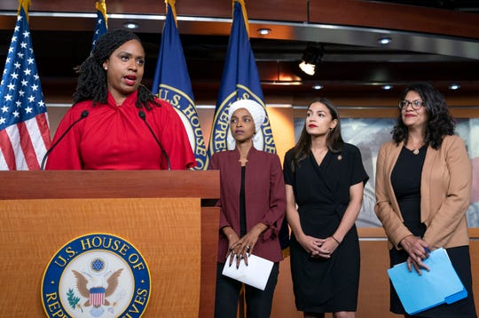 """FILE - In this July 15, 2019 file photo, from left, Rep. Ayanna Pressley, D-Mass., Rep. Ilhan Omar, D-Minn., Rep. Alexandria Ocasio-Cortez, D-N.Y., and Rep. Rashida Tlaib, D-Mich., respond during a news conference at the Capitol in Washington, to remarks by President Donald Trump after his call for the four Democratic congresswomen to go back to their """"broken"""" countries."""