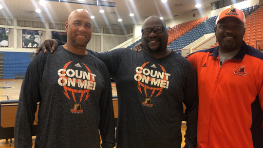 From left, former Michigan players Derrick Alexander, Will Carr and Tyrone Wheatley are coaching at Morgan State.