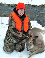 Melinda Sims, of Newfield, shows off her first deer, a doe harvested in the 2018 season.