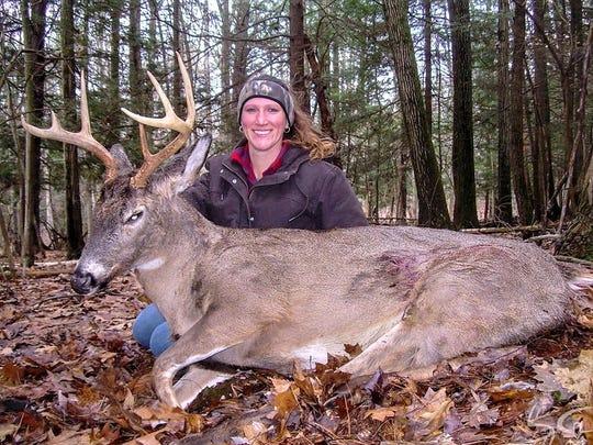 Bobbi-Jo Tallon, of Broome County, shows off a bruiser buck she shot in Pennsylvania with a flintlock rifle.