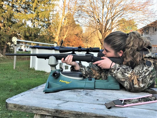 Haven Knapp, of Pine City, checks her rifle prior to the start of the 2019 firearm season for deer.