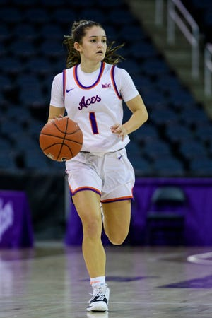 University of Evansville's Anna Newman (1) drives down the court during an education day game against the Brescia Bearcats at Ford Center in Evansville, Ind., Tuesday, Nov. 5, 2019. The Lady Purple Aces defeated the Bearcats, 77-61.