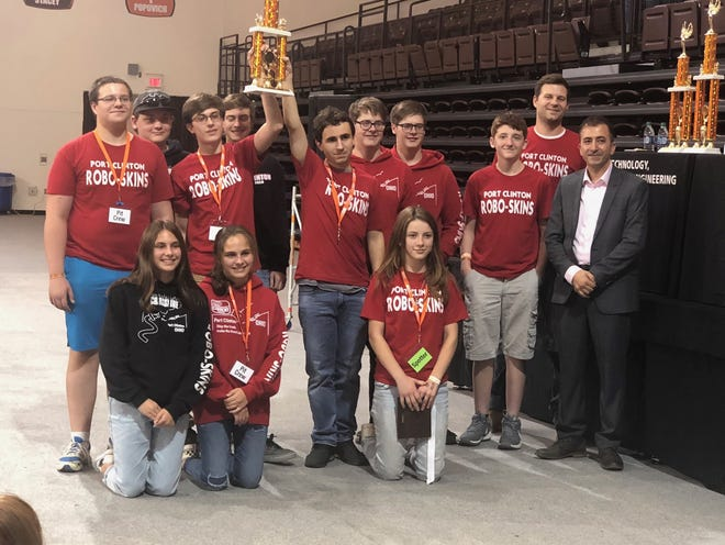 The Port Clinton High School Robotics won the Falcons BEST Robotics competition. In front, from left, are  Paige Smothers, Grace Smothers,  andSerenity Dague. In the back row are William Zimmerman, Austin Bradshaw, Dylan Smothers, Aiden Carpenter, Chase Barton, Willy Brooks, Tommy Brooks, Seth Haynes, Bobby Good, and Dr. Mohammad Mayyas of Bowling Green State University.