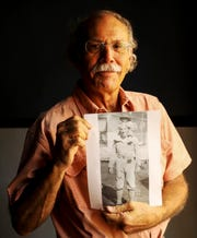 Fort Myers resident, Vic Delnore holds a photo of his father, Victor Delnore holding him as a child as he stands for a portrait at the Alliance of the Arts building in Fort Myers on Wednesday, Nov. 6, 2019. The elder Delnore made a career in the Army and retired as a full colonel. He fought in WWII and was injured along with helping rebuild Japan and the Netherlands after the war.
