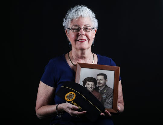 Fort Myers resident, Jan Klein holds a photo of her parents including her father, Irving Katzman Irwin. Katzman Irwin served in WWII and received three purple hearts for injuries sustained in the war. She recalls him being a great father, despite him having gone through the horrors of war. He died when she was 12 years old. He died from a heart attack, and she recalls hearing that the stress of the war contributed to his early death.