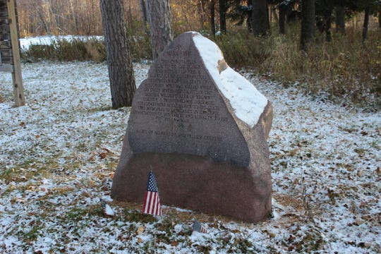 A memorial stone in the Sensiba Wildlife Area pays tribute to Neil LaFave, who was killed in 1971. The family and supporters are asking that the nearby Suamico Boat Launch be renamed in his honor.