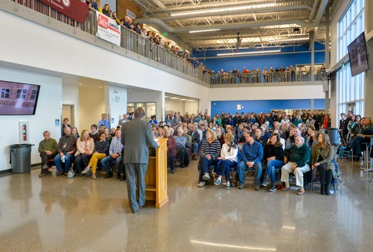 The ribbon cutting ceremony gets under way for Great Falls High's newest addition, the Hub, on Wednesday afternoon.  The Hub, which connects the main campus building to the south campus building, includes a new student commons area, administrative offices, cafeteria, classrooms and the Career and Technical Education shop facilities.
