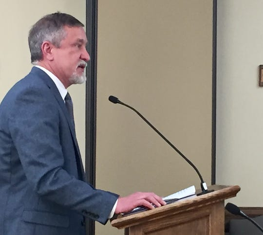 Al Garver, executive director of the Montana Dental Association, speaks Thursday to the Economic Affairs Interim Committee.