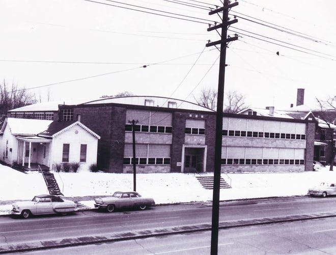 The current Holy Name School and gymnasium on Second Street as seen in the 1950s, not long after its construction in 1950-51. The old Holy Name School can be seen at the extreme far right. This building initially served as the high school, altlhougth the high school closed in May 1970. It later was expanded to the east. (Photo courtesy of Carole Summers)