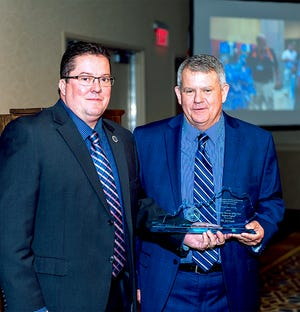 Chris Winstead, EMT-P, is pictured accepting his award from Troy Walker, President, Kentucky Ambulance Providers Association (KAPA).