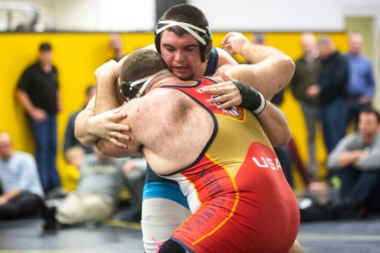 Iowa's Tony Cassipooi, right, wrestles Aaron Costello during the first day of preseason Hawkeye wrestling matches, Thursday, Nov., 7, 2019, inside the Dan Gable Wrestling Complex at Carver-Hawkeye Arena in Iowa City, Iowa.