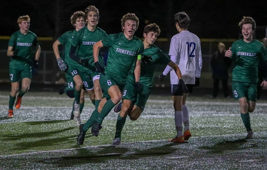 Zionsville's Chris Freeman (6) celebrates a goal against Lake Central during the IHSAA boys soccer Class 3A state final at Fishers High School on Nov. 2, 2019.