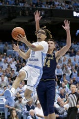North Carolina guard Cole Anthony (2) drives to the basket while Notre Dame forward Nate Laszewski (14) defends during the first half of an NCAA college basketball game in Chapel Hill, N.C., Wednesday, Nov. 6, 2019.