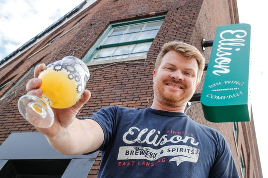 Owner Aaron Hanson holds one of his new brews at Ellison Brewing Co., 501 Madison Ave., in the former Tow Yard Brewery space, in Indianapolis on Wednesday, Nov. 6, 2019.