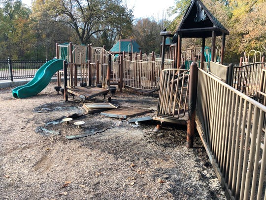 The toddler section of Holliday Park's playground is closed after a fire that occurred late Tuesday or early Wednesday.
