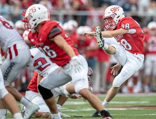 Center Grove kicker Austin Watson (98) has hit 14-for-17 field goals and all 25 of his extra points this season.