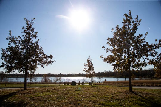 The sun soars high over the water, Thursday, Nov., 7, 2019, at Terry Trueblood Recreation Area in Iowa City, Iowa.