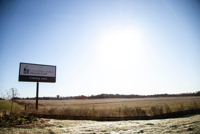 """A sign for a University of Iowa Health Care building """"coming soon"""" is pictured, Thursday, Nov., 7, 2019, at the intersection of Forevergreen Road and Coral Ridge Avenue in Johnson County, Iowa."""