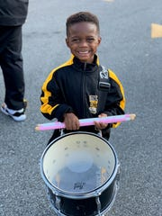 Jeremiah Travis, 5, smiles while standing at attention with his drum. Jeremiah, a band member at St. Helena College and Career Academy in Greensburg, La., was offered a full band scholarship to Alcorn State University this month.