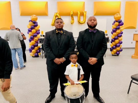 Jeremiah Travis, 5, is an instrumental part of the band at St. Helena College and Career Academy in Greensburg, La. Chesteron Frye, left, and Brandon Dorsey serve as the band director and percussion instructor respectively.