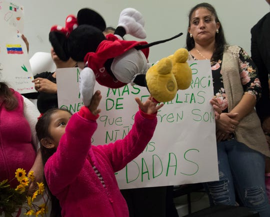 A child tosses her doll into the air during a press conference at Tougaloo College on Thursday, Nov. 7, 2019 following a Field Hearing conducted by the Committee on Homeland Security. Some families with relatives detained by ICE in the mass raids conducted across Mississippi in August attended the hearing and spoke with press. To date, administrative and or executive staff from the companies where the raids were conducted have not been arrested nor indicted.